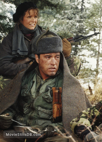 Red Dawn - Publicity still of Lea Thompson & Powers Boothe