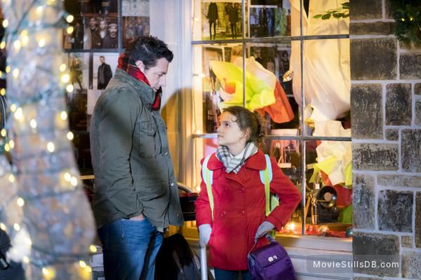 A Christmas Melody - Publicity still of Fina Strazza & Brennan Elliott
