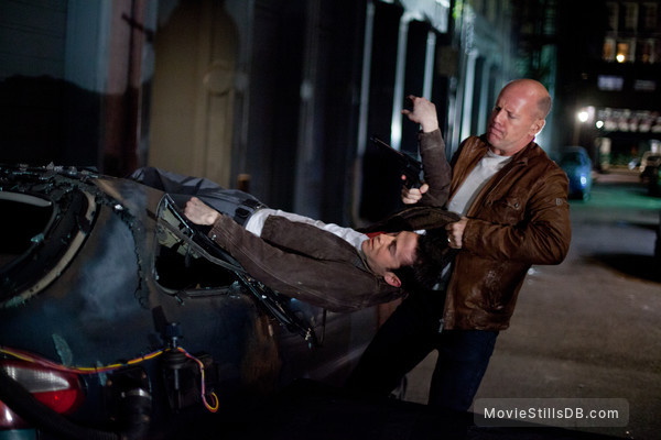 Looper - Publicity still of Bruce Willis & Joseph Gordon-Levitt