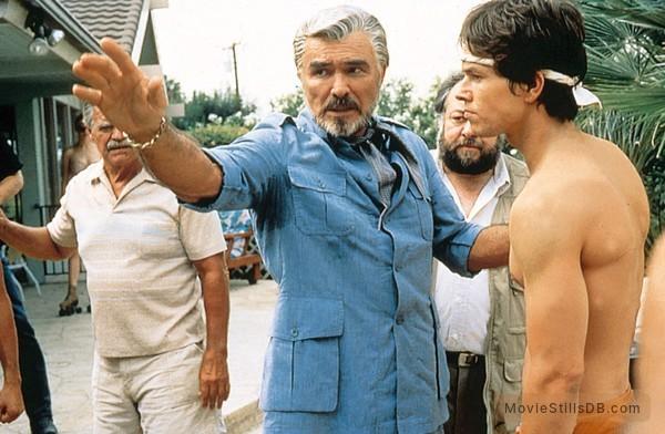 Boogie Nights - Publicity still of Burt Reynolds, Mark Wahlberg, Jack Wallace & Ricky Jay