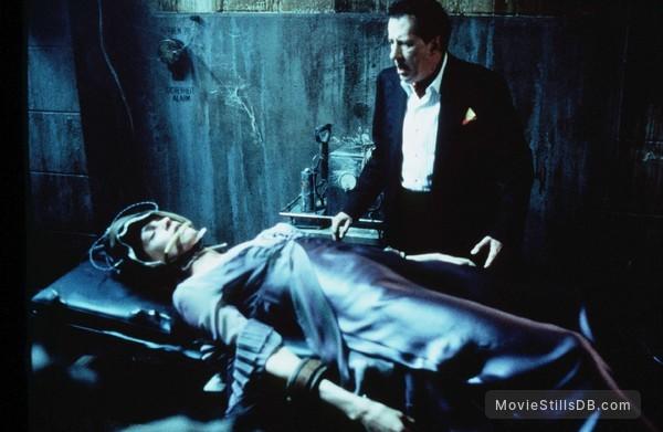 House On Haunted Hill - Publicity still of Famke Janssen & Geoffrey Rush