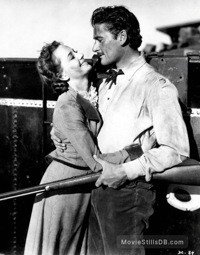 Dodge City - Publicity still of Olivia de Havilland & Errol Flynn