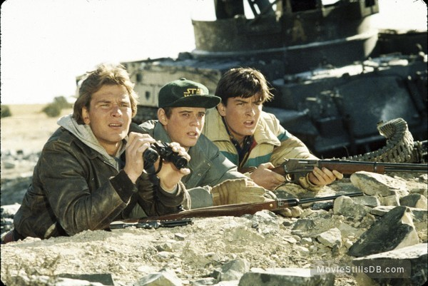 Red Dawn - Publicity still of Patrick Swayze, Charlie Sheen & C. Thomas Howell