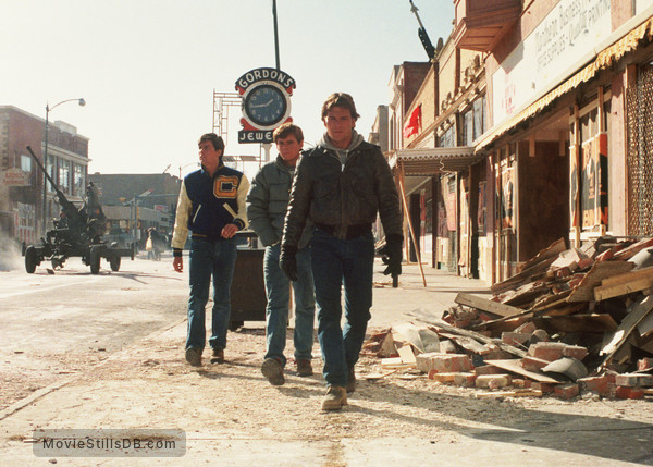 Red Dawn - Publicity still of Charlie Sheen, Patrick Swayze & C. Thomas Howell