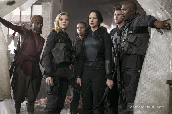 The Hunger Games: Mockingjay - Part 1 - Publicity still of Mahershala Ali, Jennifer Lawrence, Evan Ross, Natalie Dormer, Liam Hemsworth & Patina Miller
