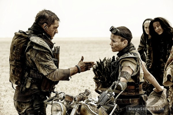 Mad Max: Fury Road - Publicity still of Charlize Theron, Tom Hardy & Megan Gale
