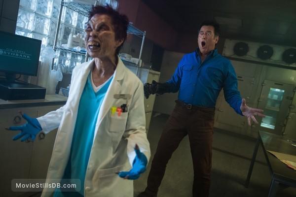 Ash vs Evil Dead - Publicity still of Bruce Campbell & Helene Wong