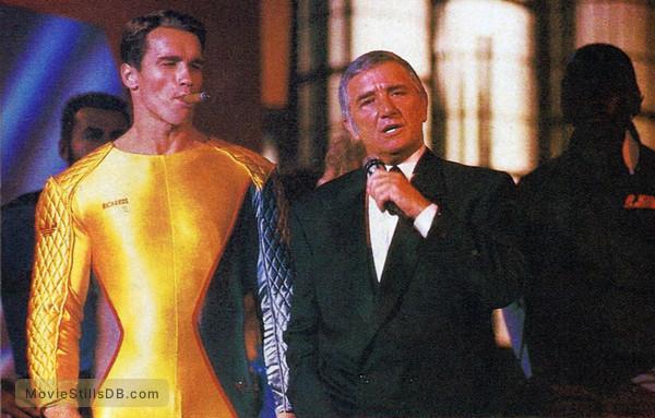 The Running Man - Publicity still of Arnold Schwarzenegger & Richard Dawson